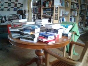 a table with lots of books on it