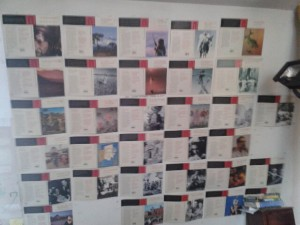 a wall with printed images and text