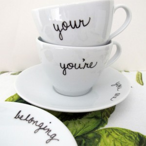 teacups with the different spelling of your and saucers